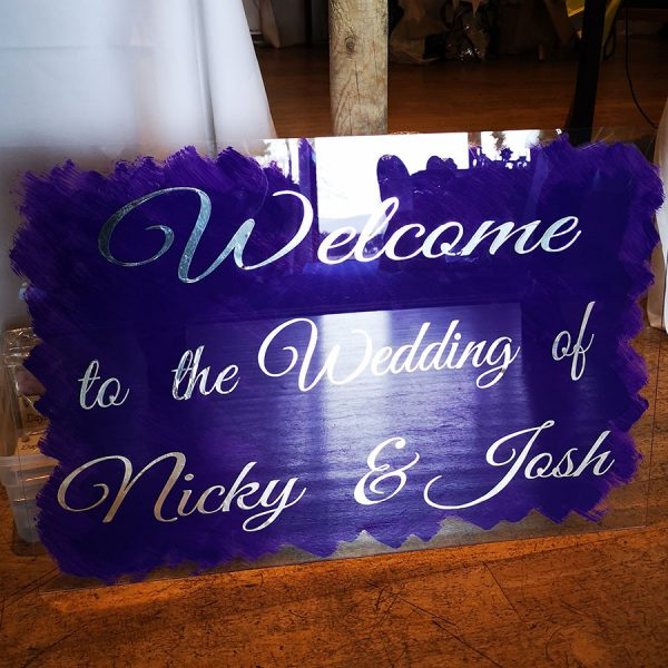 purple welcome sign